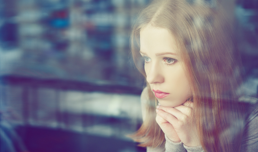 Thoughtful Sadness Girl Is Sad At Window
